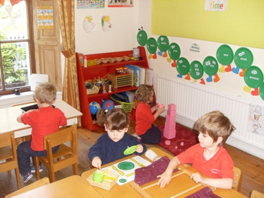 Prescool children learning at their own pace with Montessori materials